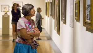 Regina Tremblay of Naples explores one of the galleries at the Portland Museum of Art, where attendance is up over last year thanks in part to a strong summer. Ben McCanna/Staff Photographer