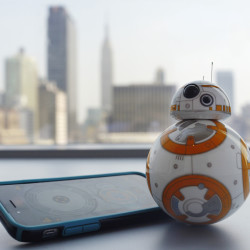 "Sphero's BB-8 droid toy  is controlled with a smartphone or tablet app and responds to basic voice commands such as ""wake up,"" and ""look around."" It's just under 5 inches tall and makes Droid sounds reminiscent of R2-D2. The Associated Press"