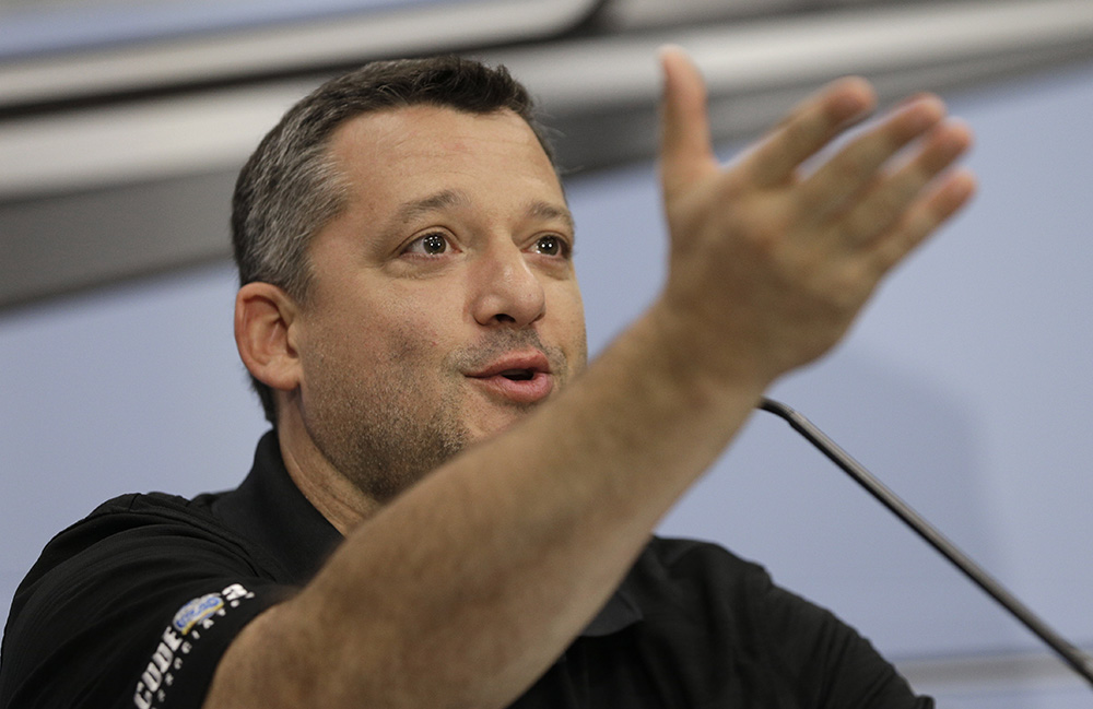Tony Stewart answers a question during a news conference to announces his retirement from driving NASCAR Sprint Cup series racing at Stewart-Haas Racing's headquarters in Kannapolis, N.C., Wednesday.