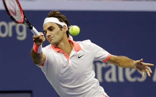 Roger Federer returns a shot to Stan Wawrinka, during their semifinal match at the U.S. Open on Friday. The Associated Press