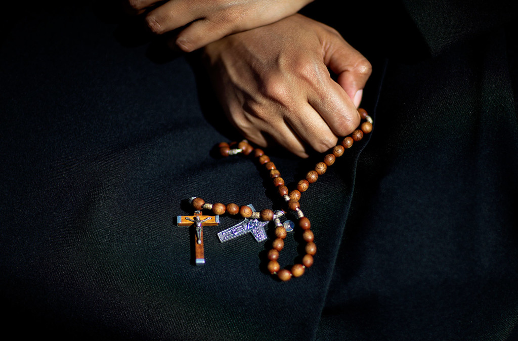 Sister Georgia of India holds her rosary beads while waiting for Pope Francis to arrive for a Mass on Wednesday outside the Basilica of the National Shrine of the Immaculate Conception in Washington.
