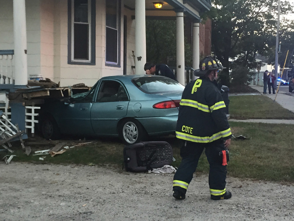 One person was taken to a hospital after this car crashed into the house at 234 Woodford St. in Portland on Wednesday.