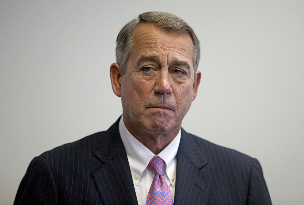 Outgoing House Speaker John Boehner of Ohio stands to the side during a news conference on Capitol Hill recently. The Associated Press