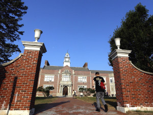 A student heads into Deering High School on Wednesday, the first day back to school. Derek Davis/Staff Photographer