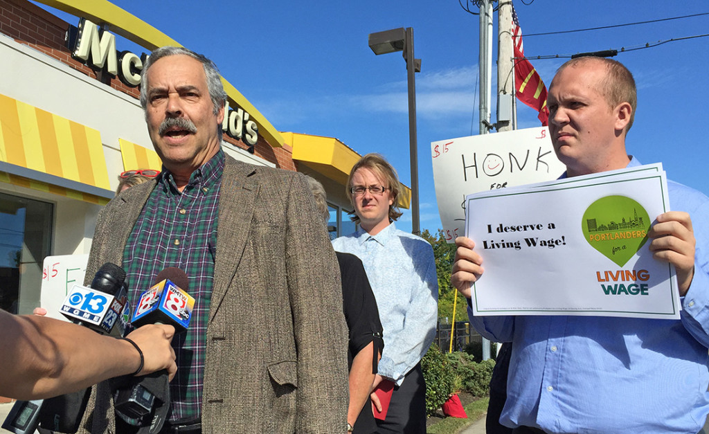 Harlan Baker of the Southern Maine Labor Council, left, speaks at a news conference outside McDonald's restaurant in Portland on Monday to promote a proposed $15-per-hour citywide minimum wage that goes to city voters Nov. 3. At right is Tom MacMillan, chairman of the Portland Green Independent Committee and candidate for mayor.