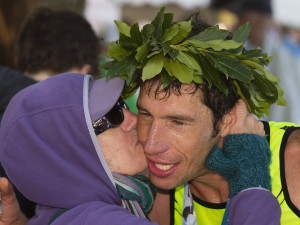 Winner Evan Graves of Caribou receives a kiss from his mother, Roxie Brechlin, at the finish line during Sunday's Maine Marathon in Portland. Carl D. Walsh/Staff Photographer