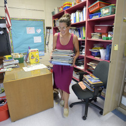 Talya Edlund, third-grade teacher at Cape Elizabeth's Pond Cove Elementary School, gets her classroom ready for the upcoming school  in this Aug. 25, 2015, photo. Shawn Patrick Ouellette/Staff Photographer