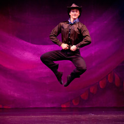"Nicholas Anderson executes a leap in ""Western Roundup,"" a ballet produced by Maine State Ballet in Falmouth."