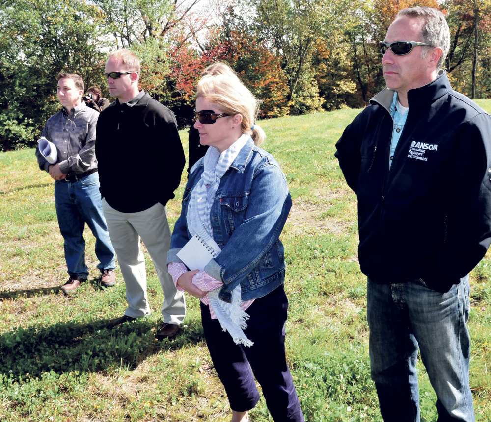 Watching speakers during a ribbon cutting ceremony at the site of the former Wilton Tannery are from left, Steve Govoni of Wentworth Partners, owner John Black, Amy Jean McKeown of the EPA and Nick Sabatine of Ransom Consultants on Thursday.
