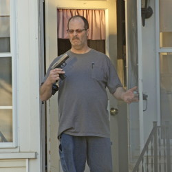 A photo taken in May 2014 by Barry Sturk shows Wilfred Morissette holding a handgun on First Street in Winslow. Wilfred Morissette pleaded guilty Thursday to pointing a loaded gun at two of his sons and Sturk, the boyfriend of his ex-wife.
