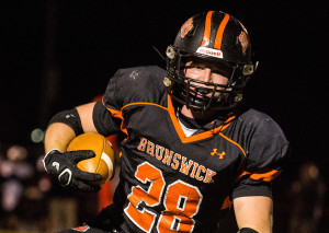 Brunswick running back Will Bessey gets a first down against Skowhegan in Friday night's game Brunswick.