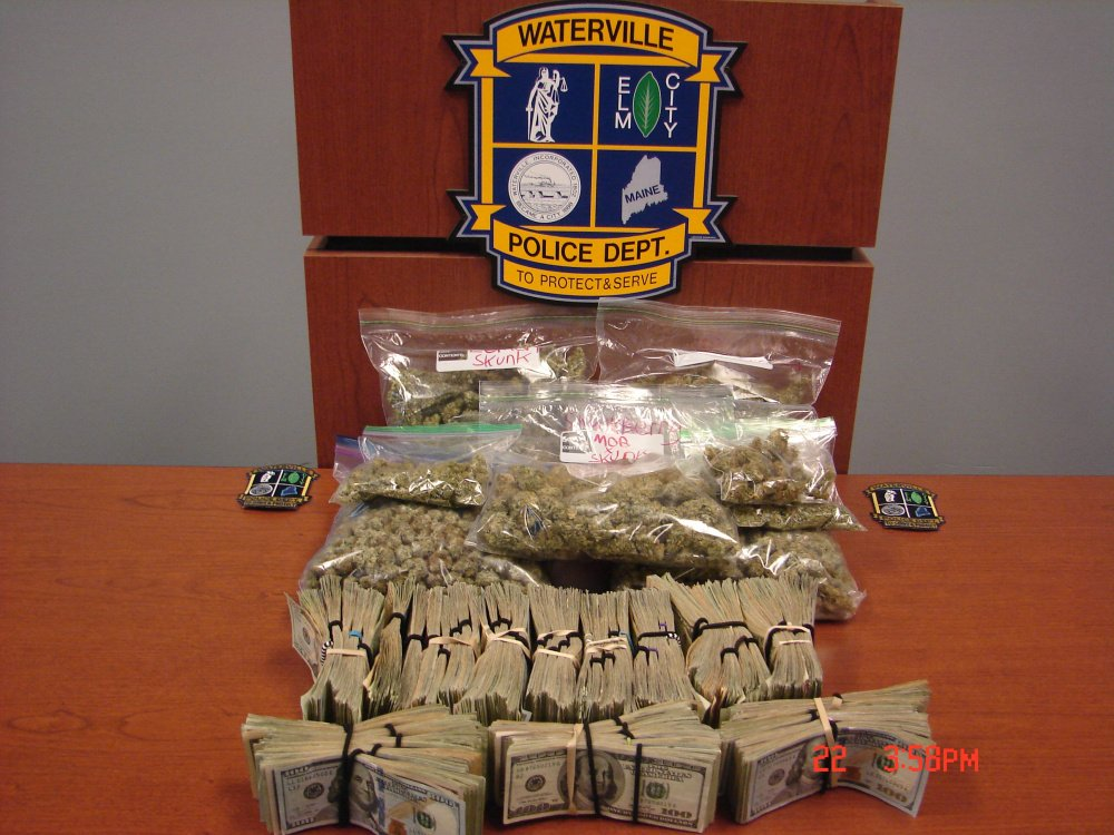 Waterville police seized 1.9 pounds of marijuana and $57,000 in cash from an Oak Street apartment in a search Thursday afternoon. Edward Dawe, 24, was arrested and charged with several trafficking counts.
