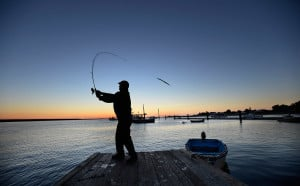 David Forbes of Saco fishes for stripers from the docks at Camp Ellis just before sunrise on a cool October morning.