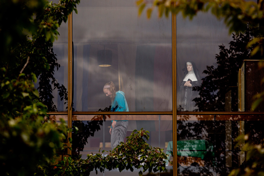 A student at Catherine McAuley High School is seen inside the school with friends Wednesday, next to a statue of Mother Catherine Elizabeth McAuley, an Irish nun who founded the Sisters of Mercy in 1831. The school announced Wednesday it would be ending its relationship with the sisters in 2016.