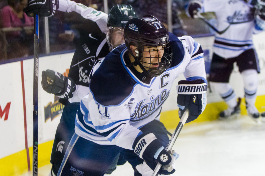 Maine senior Steven Swavely looks for an opening in the second period against Michigan State at Cross Insurance Arena. He scored in a shootout to give Maine a 4-3 win in the Ice Breaker tournament. Ben McCanna/Staff Photographer