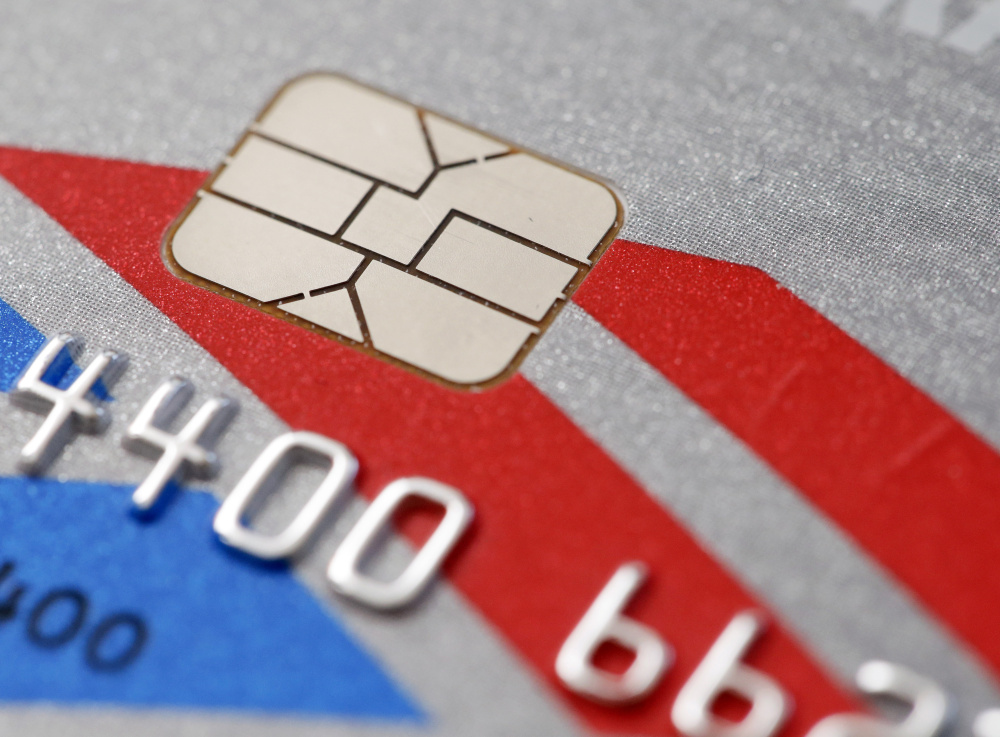 "The new credit cards with embedded microchips are ""dipped"" into a slot for five or 10 seconds, rather than quickly swiped like magnetic-strip cards."
