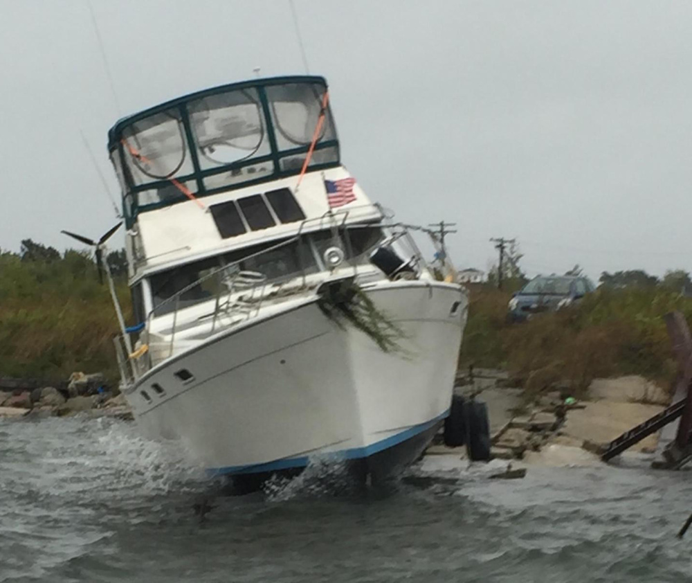 This Bayliner washed ashore at Bug Light in South Portland on Wednesday.