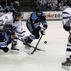 New Hampshire's Nick Sorkin (21) works to control a face-off against Maine's Jon Swavely (18) and Steven Swavely (11)  in 2013. Steven Swavely is the Black Bears' captain this season.
