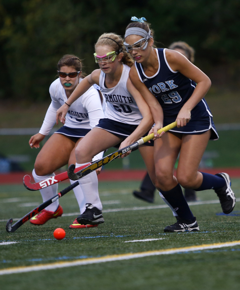 Lily Posternak, a junior who recently verbally committed to play field hockey at Duke, pushes the ball down the field Thursday for York during a 1-0 victory against Yarmouth.