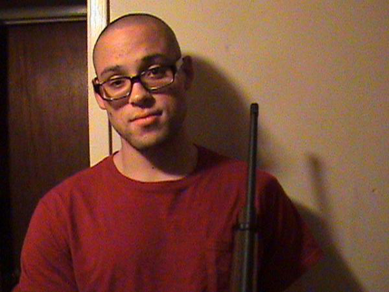 This undated photo from a MySpace page that appeared to belong to Chris Harper-Mercer shows him holding a rifle. Authorities identified Mercer as the gunman who went on a deadly shooting rampage at Umpqua Community College in Roseburg, Ore., on Thursday.