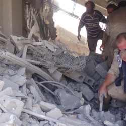 A volunteer search and rescue group shows the aftermath of an airstrike in Talbiseh, Syria, on Wednesday, when Russia carried out its first airstrikes in Syria.
