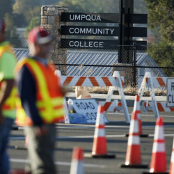 Authorities block a road leading to the Umpqua Community College on Friday in Roseburg, Ore.