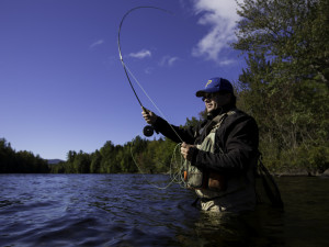 Tim Richardson of Dover-Foxcroft casts a line into the Kennebec River. He commutes more than two hours to his job in Ellsworth in order to live in the Moosehead region.