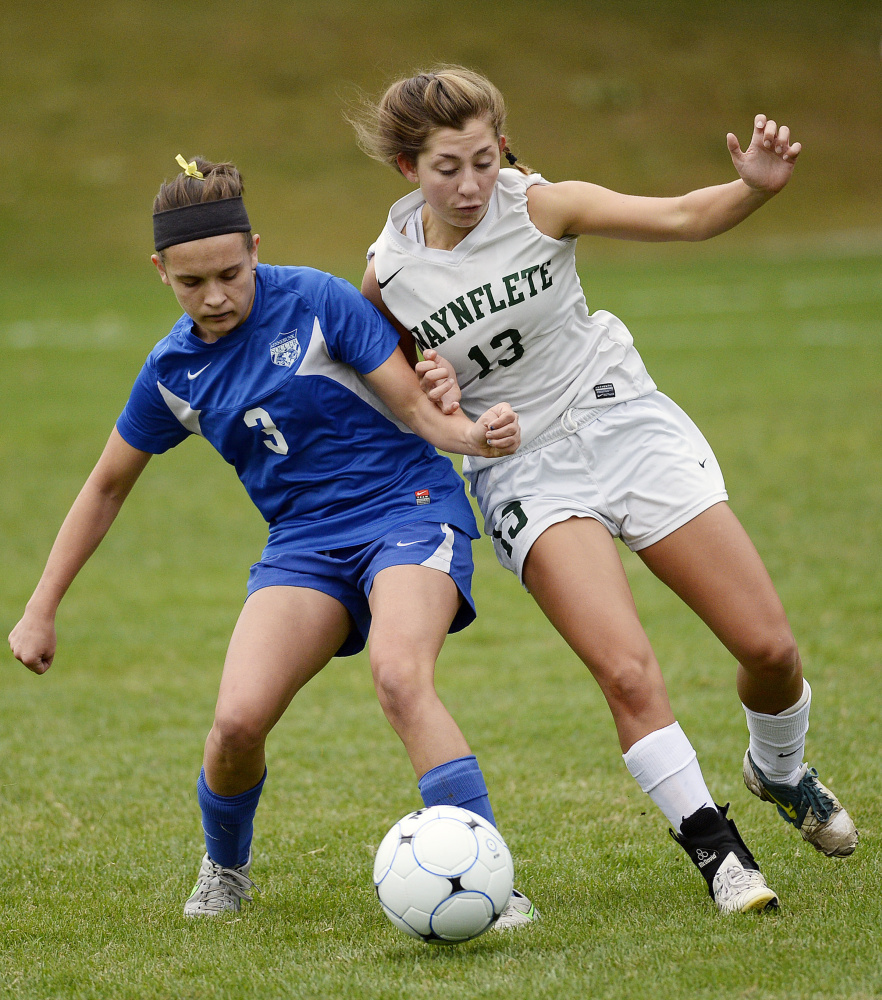 Sarah Thill of Kennebunk, left, who assisted on the only goal of the game, attempts to keep the ball from Amelia Bertaska of Waynflete. Kennebunk improved to 3-4-2 and dropped the Flyers to 7-2.