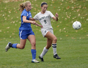 Esme Benson of Waynflete, right, attempts to beat Sierra Tartre of Kennebunk to the ball Friday during their Western Maine Conference girls' soccer game at Fore River Fields in Portland. Kennebunk won, 1-0.