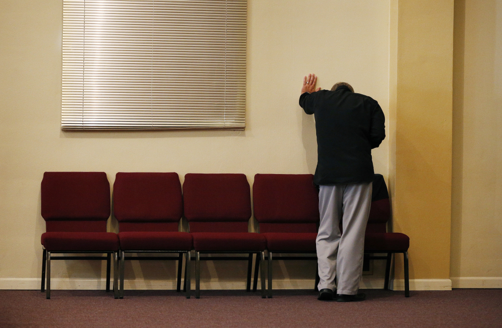 Pastor Randy Scroggins, of the New Beginnings Church of God, cries in his Roseburg, Ore., church Saturday after speaking with the mother of one of the nine people shot and killed by Christoper Sean Harper-Mercer this past Thursday.