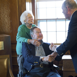 Former President George H.W. Bush, with his wife Barbara, speaks with former baseball teammate Richard Phelps, during a visit to Phillips Academy in Andover, Massachusetts. Bush is healing well after taking a fall this summer.