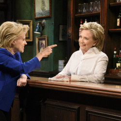"Kate McKinnon, left, portrays Hillary Clinton, and Hillary Clinton, right, portrays Val, a bartender, during a sketch on ""Saturday Night Live"" in New York on Saturday."