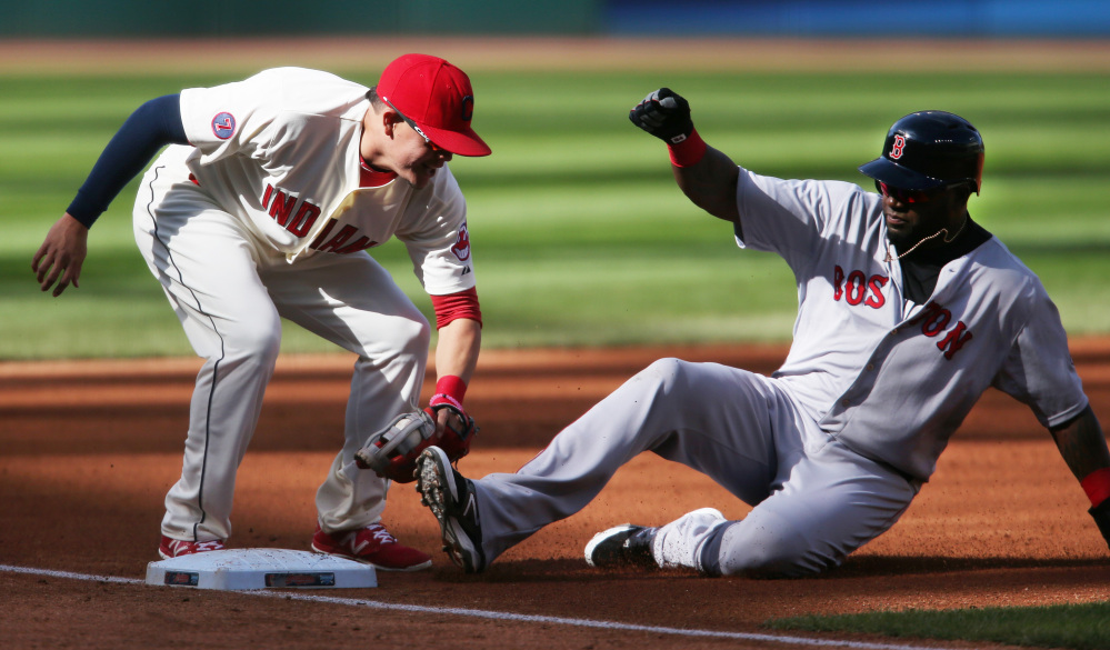 Boston's David Ortiz, right, is tagged out by Cleveland's Giovanny Urshela while attempting to steal third base during the first inning Sunday in Cleveland.