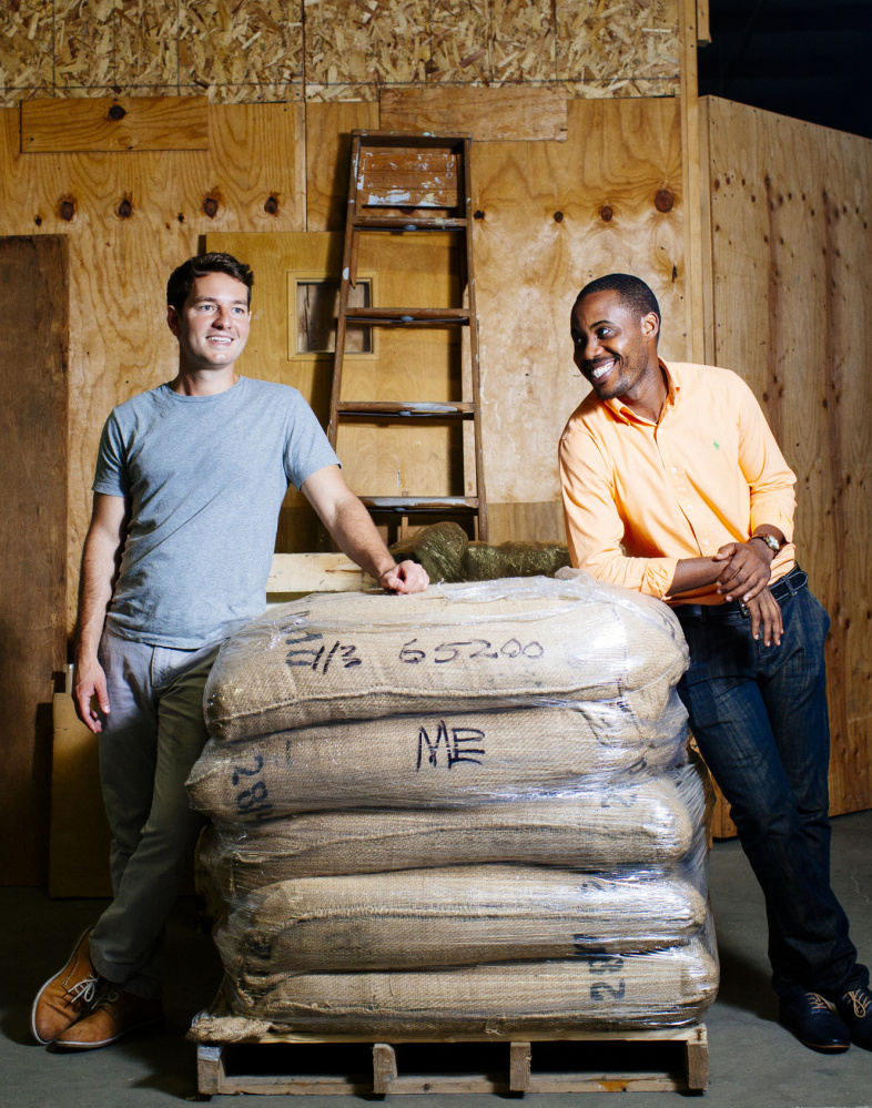Rwanda Bean Co. founders Nick Mazuroski, left, and Mike Mwenedata aim to make a difference in the East African nation of Rwanda, where Mwenedata fled genocide.
