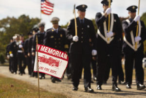 Portland and South Portland fire department members march toward the Portland Veteran Firemen's Association monument during the annual Memorial Sunday Service at Forest City Cemetery in South Portland on Sunday.