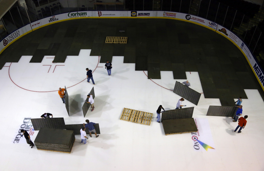 Crews prepare the ice at Cross Insurance Arena for a hockey game last October. A rink's size and condition are factors in winning a bid to host NCAA Regionals.