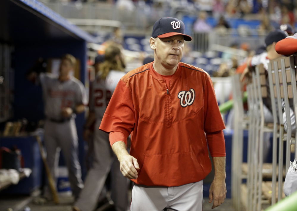 In this photo taken Sept. 13, 2015, Washington Nationals manager Matt Williams walks in the dugout during a baseball game against the Miami Marlins in Miami.