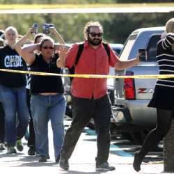 FILE - In this Thursday, Oct. 1, 2015 file photo, students, staff and faculty are evacuated from Umpqua Community College in Roseburg, Ore., after a deadly shooting. Harper-Mercer took multiple lives Thursday in chilling fashion before killing himself as officers closed in, placing the small town of Roseburg among settings that have become infamous for inexplicable violence. (Michael Sullivan /The News-Review via AP, File) MANDATORY CREDIT