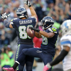 Seattle wide receiver Doug Baldwin, center, celebrates with teammate Jimmy Graham after Baldwin scored a touchdown in the first half Monday against Detroit in Seattle. The Seahawks won, 13-10.
