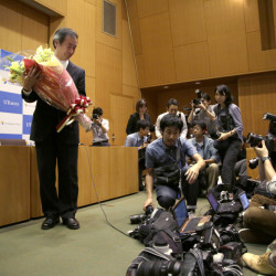 Takaaki Kajita of Japan receives flowers during a news conference Tuesday in Tokyo.