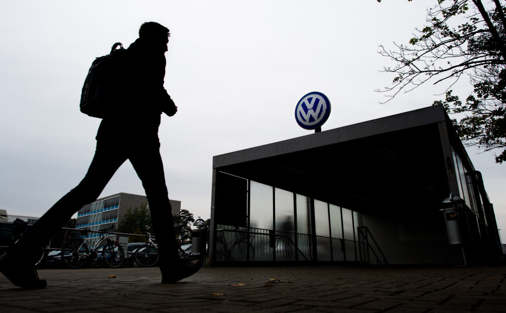 An employee enters the Volkswagen factory site in Wolfsburg, Germany.