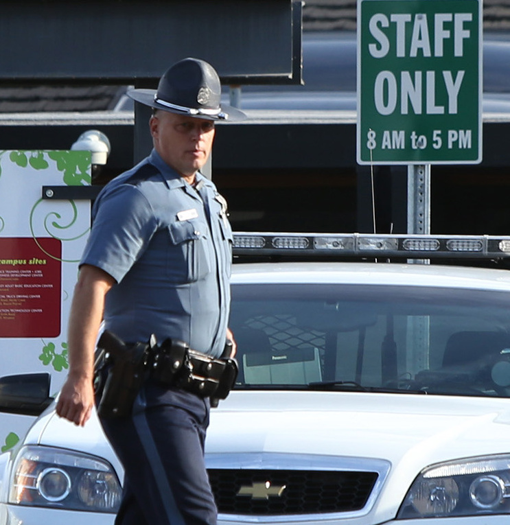 State troopers continue to be a familiar sight on the campus of Umpqua Community College near Roseburg, Ore.