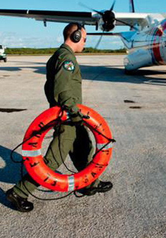 A life ring from the El Faro is taken back to the U.S. in this photo provided by the Coast Guard on Tuesday.  Coast Guard/Handout via Reuters