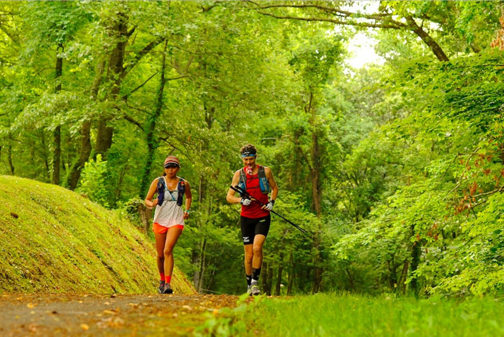 Jenny and Scott Jurek run toward Fontana Dam in North Carolina on the fourth day of Scott's record-breaking trek along the Appalachian Trail.