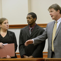 Abil Teshome, center, 23, of Portland, appears in a Cumberland County courtroom with his attorneys Alison Meyers and Jon Gale on Tuesday.