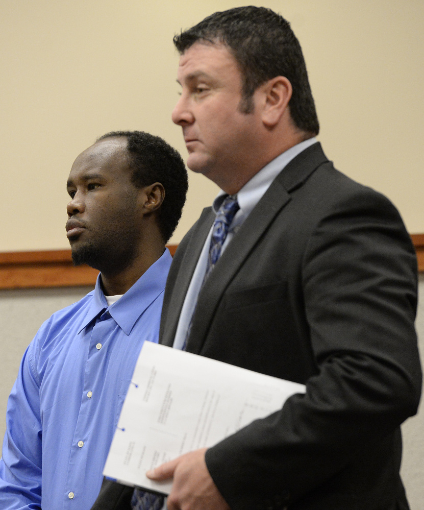 Osman Sheikh, left, 31, of Portland, pleads not guilty in the death of Freddy Akoa, at the Cumberland County Courthouse on Tuesday.