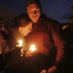 CASTINE, ME - OCTOBER 6: Travis Emerson, right, comforts Alexi Galley after a vigil for the crew members of the cargo ship El Faro, which is believed to have sunk off the Bahamas during Hurricane Joaquin. Four of the ship's crew, Capt. Michael Davidson of Windham, Michael Holland of Wilton, Danielle Randolph of Rockland and Dylan Meklin, both of Rockland, are all graduates of Maine Maritime Academy. (Photo by Gregory Rec/Staff Photographer)