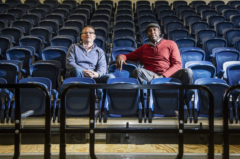 Bill Ryan Jr., left, the principal owner of the Maine Red Claws, and Dajuan Eubanks, the team president, sit in the new stadium seats at the Portland Expo. The public can inspect the seats from 10 a.m. to 2 p.m. Saturday.