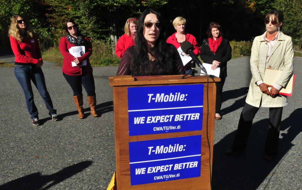 Former T-Mobile employee Angela Agganis addresses the media outside the company's Oakland call center. She is taking the call center to court after she was told she could be fired if she didn't sign a confidentiality agreement with the company saying she wouldn't discuss a sexual harassment charge she had brought against her supervisor. She is surrounded by members of the Communications Workers of America union and her attorney, Allison Gray, at right.
