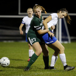 Marijke Rowse of Waynflete, left, and Courtney Ryan of Sacopee Valley battle for the ball during the first half of the Hawks' 7-0 win Tuesday in Hiram. Derek Davis/Staff Photographer
